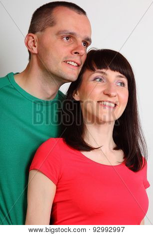 Smiling Woman And Man Looking Into Distance