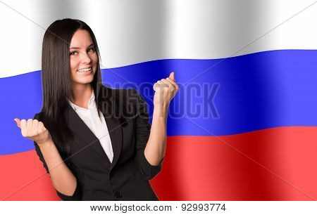 Smiling woman in winner posture