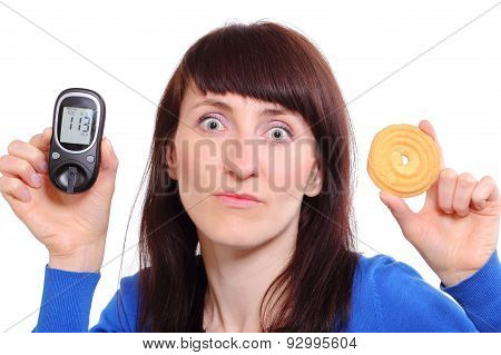 Woman Holding Glucose Meter And Cake