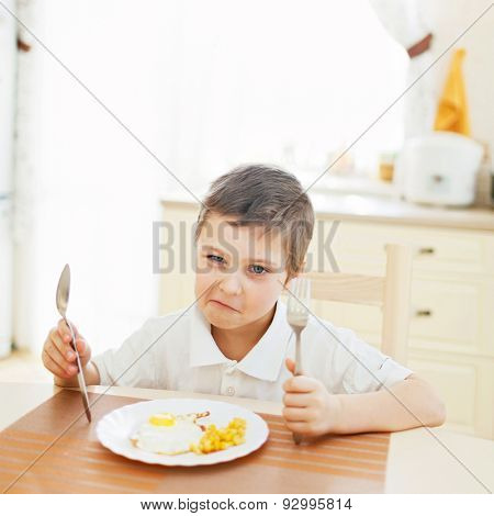 Portrait of little boy in the kitchen
