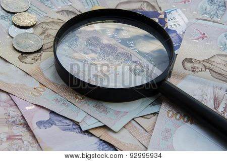 magnifying glass and the money