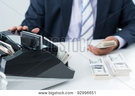 Using Money Counting Machine