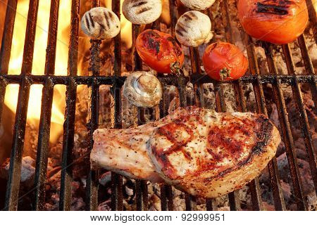 Pork Rib Steak, Tomato And Mushrooms On Hot Bbq Grill
