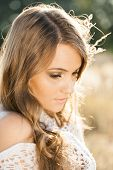 picture of tallgrass  - Portrait of young beautiful model at sunrise - JPG
