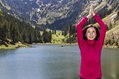stock photo of namaste  - Attractive caucasian yogi woman in namaste pose outdoors in nature in spring - JPG