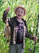foto of rod  - Young fisherman caught fish bream on fishing rod - JPG