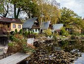 image of chalet  - Few chalets on a bank of a lake in autumn - JPG