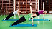 pic of virabhadrasana  - Girls practicing yoga - JPG