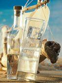 stock photo of ouzo  - Traditional Greek ouzo at the beach - JPG