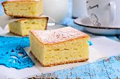 picture of sponge-cake  - Piece of sweet sponge cake on paper in rustic style - JPG