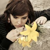 picture of tombstone  - Sad young woman with a flowers lying on tombstone  - JPG