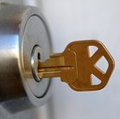 stock photo of locksmith  - Photograph of a key in a door lock.