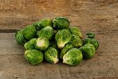 picture of brussels sprouts  - few Brussels sprouts on old wooden table - JPG