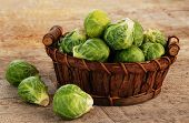 image of brussels sprouts  - Basket of fresh green brussels sprouts on wooden background - JPG
