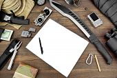 picture of torches  - Rough Wood Desktop With Objects For Travel Expedition Exploration Or Hike - JPG