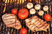 foto of rib eye steak  - BBQ Pork Rib Pepper Steak Tomato And Mushrooms On The Hot Flaming Charcoal Grill Overhead View - JPG