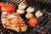picture of rib eye steak  - BBQ Pork Rib Pepper Steak Tomato And Mushrooms On The Hot Flaming Charcoal Grill - JPG