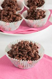 stock photo of crispy rice  - Chocolate covered crispy rice cakes or rice bubble cakes a favorite party treat - JPG