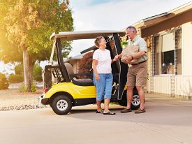 picture of grocery cart  - active senior couple coming home with groceries on golf cart - JPG