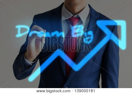 Businessman Drawing Dream Big And Upward Graph Arrows Forward