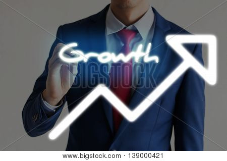 Businessman Drawing Growth And Upward Graph Arrows Forward