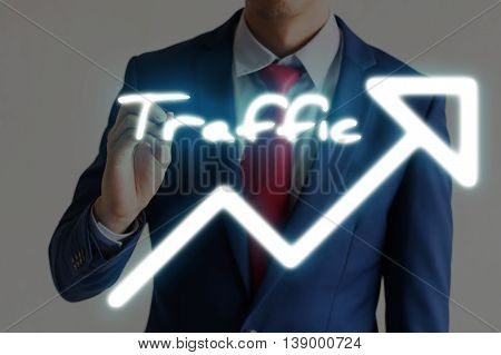 Businessman Drawing Traffic And Upward Graph Arrows Forward