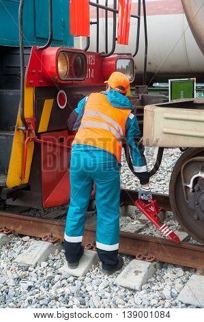 Tobolsk, Russia - July 15. 2016: Sibur company. Process coupling locomotive rolling stock