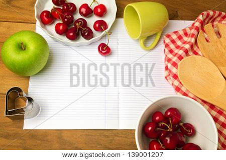 Recipe design page with blank notebook cherries and kitchen utensil