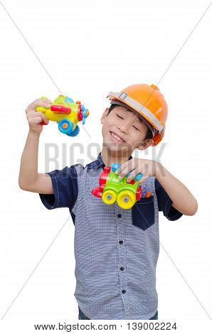 Little Asian boy playing with plane and train toy