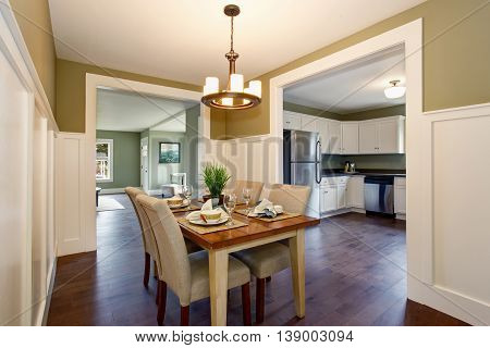 Dining Area With Soft Chairs And Hardwood Floor