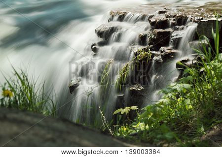 Tight shot of a detailed mini waterfall.