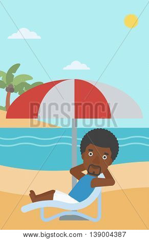 An african-american man sitting in a chaise longue on the beach. An african-american man relaxing while sitting under umbrella on the beach. Vector flat design illustration. Vertical layout.