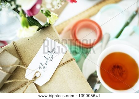 Present Package Thank you Message Teacup Flowers Concept