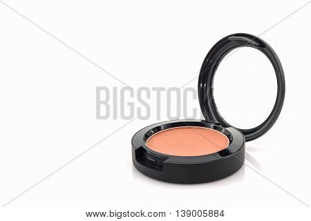 Closeup of face powder on white background.