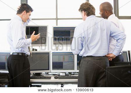 Stock Traders Viewing Monitors