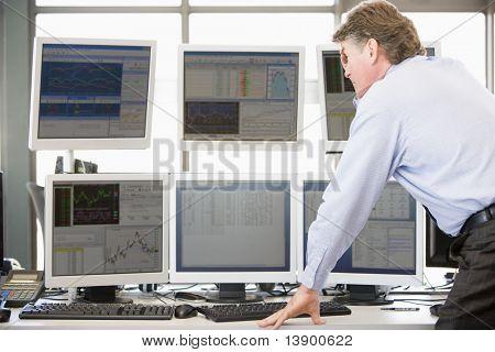 Stock Trader Examining Computer Monitors