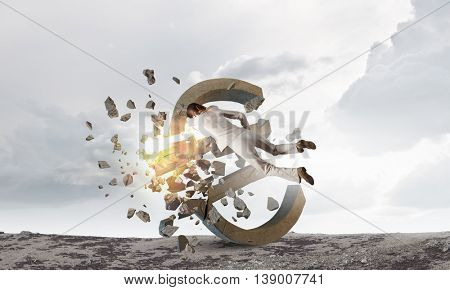 Woman attacking euro symbol . Mixed media
