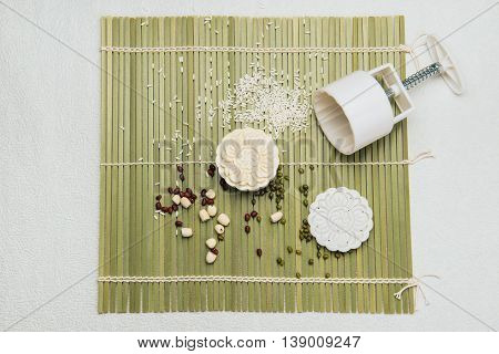 Making mooncakes with plastic mold. Traditional mooncakes on table setting