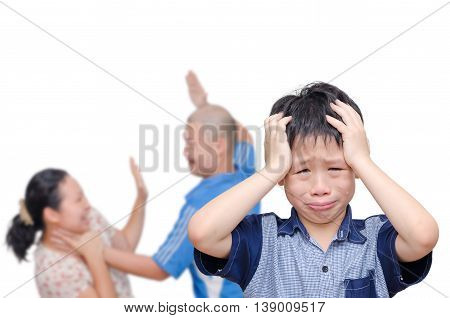 Asian boy crying with his parent fighting in background