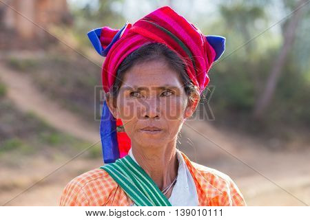 INLE LAKE MYANMAR - JANUARY 12 2016: Unidentified woman in market. The local people are hospitable and friendly to tourists