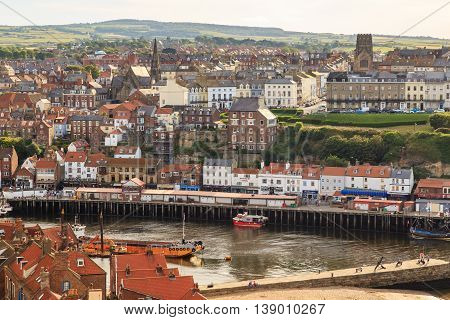WHITBY ENGLAND - JULY 16: Whitby harbour and town behind. In Whitby North Yorkshire England. On 16th July 2016.