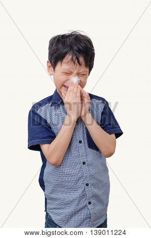 Little Asian boy wipes his nose by tissue paper over white background