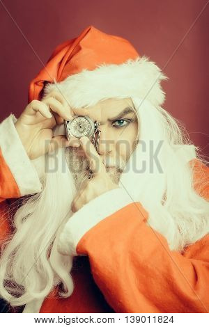 Serious Christmas Man With Clock On Chain