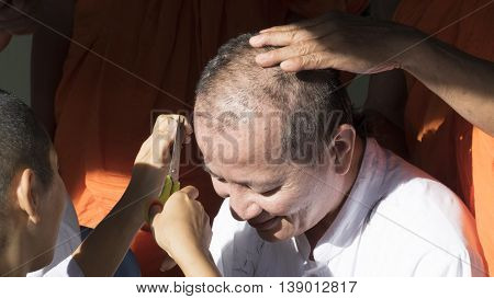 People Cut Hair Of Man Who Will Become Buddhism Monk In Ordination Ceremony