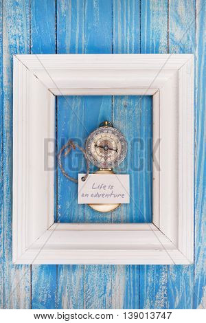Sign Life Is An Adventure And Compass In A White Frame - Vintage Style