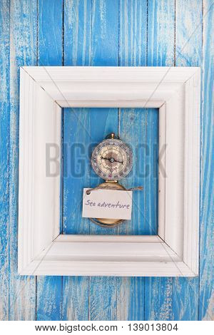 Sign Sea Adventure And Compass In A White Frame - Vintage Style