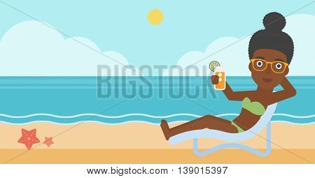 An african-american woman sitting in a chaise longue and holding a cocktail in hand on the background of sand beach with blue sea. Vector flat design illustration. Horizontal layout.