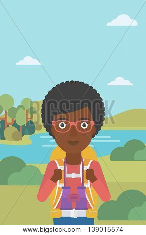 An african-american woman with backpack walking in the mountains. Female backpacker with binoculars. Female traveler hiking in mountains. Vector flat design illustration. Vertical layout.