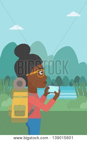 An african-american woman taking photo of landscape with mountains. Young hiking woman with backpack taking photo with her cellphone. Vector flat design illustration. Vertical layout.