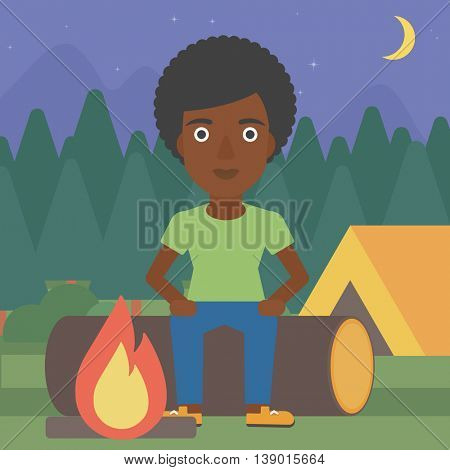 An african-american woman sitting on a log near a fire on a background of camping site with tent. Woman sitting near a campfire at a campsite. Vector flat design illustration. Square layout.